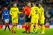 The Villarreal players surround the Referee Matej Jug (SVN) during the Europa League group stage match between Rangers FC and Villareal CF at Ibrox, Glasgow, Scotland on 29 November 2018.