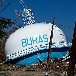 The water tower from Buras on the ground following the devastation left in the aftermath of Hurricane Katrina that flooded the small city of Buras, Louisiana in Plaquemines Parish on August 29, 2005. ..(Mandatory Credit: Photo by Derick E. Hingle)