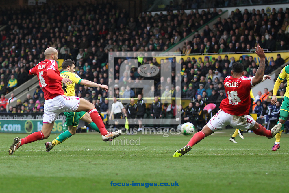 Wes Hoolahan of Norwich has a shot on goal during the Sky Bet Championship match at Carrow Road, Norwich<br /> Picture by Paul Chesterton/Focus Images Ltd +44 7904 640267<br /> 21/03/2015