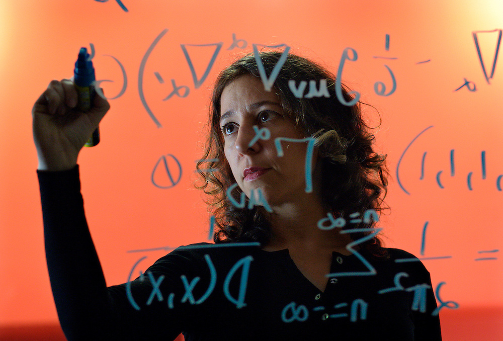 UK ENGLAND OXFORD 3DEC03 - Research Fellow in Astrophysics at Oxford University, Janna Levin writes a mathematical model on the glass wall of her office. Last year she published her first book titled 'How the Universe Got Its Spots' - Diary of a Finite Time in a Finite Space - in which she argues her mathematical model of a finite universe.<br /> Photography by Jiri Rezac<br /> Tel 0044 07947 884 517<br /> www.linkphotographers.com