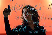 UK ENGLAND OXFORD 3DEC03 - Research Fellow in Astrophysics at Oxford University, Janna Levin writes a mathematical model on the glass wall of her office. Last year she published her first book titled 'How the Universe Got Its Spots' - Diary of a Finite Time in a Finite Space - in which she argues her mathematical model of a finite universe.<br />