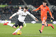Derby County forward Jack Marriott strikes at goal during the EFL Sky Bet Championship match between Derby County and Millwall at the Pride Park, Derby, England on 20 February 2019.