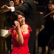 """November 11, 2012 - New York, NY : Accompanied by members of the Metropolitan Opera Orchestra and The New York Choral Society, and conducted by Patrick Summers, soprano Ailyn Pérez (in red) performs Jules Massenet's """"Je marche sur tous les chemins!... Obéissons quand leur voix appelle"""" from Manon during the 2012 Richard Tucker Gala and concert in Lincoln Center's Avery Fisher Hall on Sunday evening. """"""""Pérez was this year's recipient of the Richard Tucker award."""""""" CREDIT: Karsten Moran for The New York Times"""