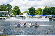 Henley on Thames, England, United Kingdom, 2nd July 2019, Henley Royal Regatta,  Newcastle University Quad scull past the progress on Henley Reach, [© Peter SPURRIER/Intersport Image]<br /> <br /> 12:19:38 1919 - 2019, Royal Henley Peace Regatta Centenary,