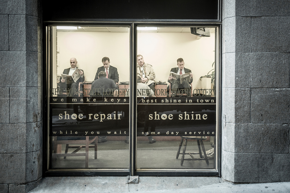 TIP EXCHANGE: Businessmen gets a polish and some time to read the newspaper at the Stanley Shoe Repair. The store has the best shoe shine in the area, according to Wall Street insiders.