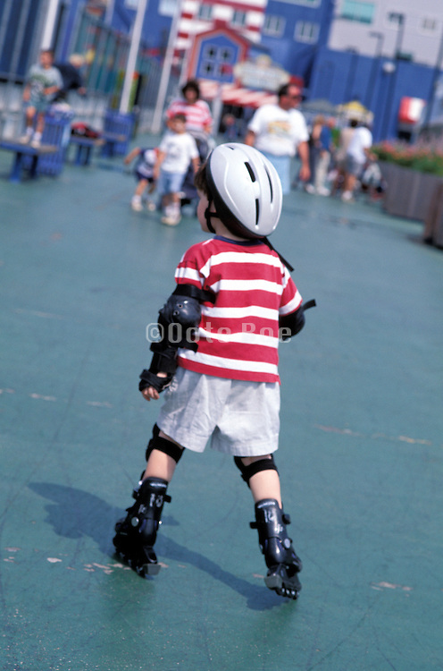 young boy roller blading alone