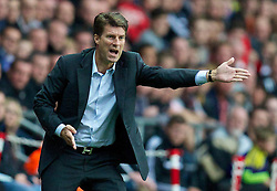 28.09.2013, Liberty Stadion, Swansea, ENG, Premier League, Swansea City vs FC Arsenal, 6. Runde, im Bild Swansea City's manager Brian Laudrup urges his side on against Arsenal during the English Premier League 6th round match between Swansea City AFC and Arsenal FC at the Liberty Stadium, Swansea, Great Britain on 2013/09/28. EXPA Pictures &copy; 2013, PhotoCredit: EXPA/ Propagandaphoto/ David Rawcliffe<br /> <br /> ***** ATTENTION - OUT OF ENG, GBR, UK *****