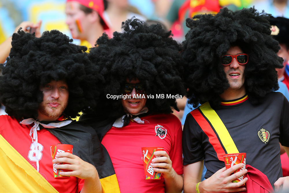 Fans of Marouane Fellaini of Belgium wearing black wigs