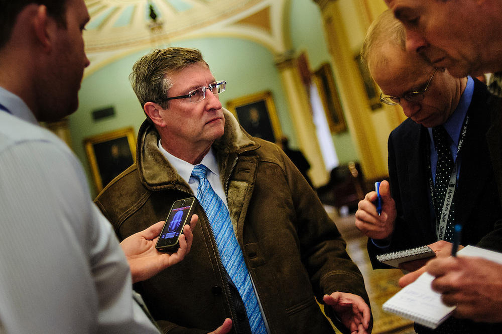 Senator Kent Conrad (D-ND) is questioned by reporters outside of the Senate Chamber on Sunday. Fiscal cliff negotiations continue at the U.S. Capitol in Washington, District of Columbia, U.S., on Sunday, Dec. 30, 2012. A combination of spending cuts and tax increases are set to kick in within hours unless congressional Republicans and Democrats cut a last-minute deal. Photographer: Pete Marovich/Bloomberg