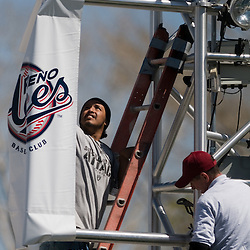 Maintenance hanging banners in right field. Photo by David Calvert/Reno Aces