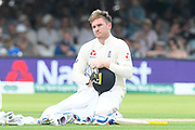 Jason Roy of England dries his helmet with a towel in the drinks break during the International Test Match 2019 match between England and Ireland at Lord's Cricket Ground, St John's Wood, United Kingdom on 25 July 2019.