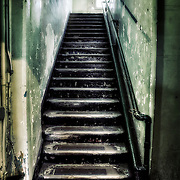 A dark spooky stairway leading to the Alcatraz prison hospital. Photo by jennifer Rondinelli Reilly. All Rights Reserved. NO USE WITHOUT PERMISSION.