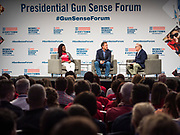10 AUGUST 2019 - DES MOINES, IOWA: DEANDRA YATES DYCUS, Everytown Survivor Fellow, (left), Governor STEVE BULLOCK (D-MT), a Democratic Presidential candidate, and JOHN FEINBLATT, President of Every Town for Gun Safety, talk about gun safety legislation at the Presidential Gun Sense Forum. Several thousand people from as far away as Milwaukee, WI, and Chicago, came to Des Moines Saturday for the Presidential Gun Sense Forum. Most of the Democratic candidates for president attended the event, which was organized by Moms Demand Action, Every Town for Gun Safety, and Students Demand Action.      PHOTO BY JACK KURTZ