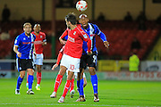 Calvin Andrew heads under pressure from Johnny Goddard during the EFL Sky Bet League 1 match between Swindon Town and Rochdale at the County Ground, Swindon, England on 18 October 2016. Photo by Daniel Youngs.
