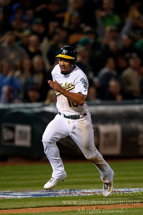 OAKLAND, CA - APRIL 04:  Marcus Semien #10 of the Oakland Athletics scores a run against the Los Angeles Angels of Anaheim during the seventh inning at the Oakland Coliseum on April 4, 2017 in Oakland, California. The Los Angeles Angels of Anaheim defeated the Oakland Athletics 7-6. (Photo by Jason O. Watson/Getty Images) *** Local Caption *** Marcus Semien