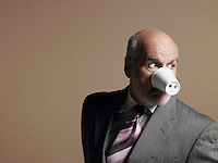 Businessman Wearing Plastic Cup as Pig Snout