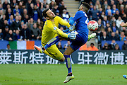 Swansea City goalkeeper Lukasz Fabianski and Leicester City midfielder Riyad Mahrez  collide during the Barclays Premier League match between Leicester City and Swansea City at the King Power Stadium, Leicester, England on 24 April 2016. Photo by Alan Franklin.