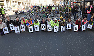 Cyclists gets their message across during the Time To Act, National Climate March organised by Campaign Against Climate Change in London, England on March 7, 2015