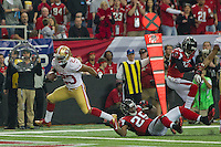 20 January 2013: Runningback (23) LaMichael Jomes of the San Francisco 49ers catches a pass and scores a touchdown against the Atlanta Falcons during the first half of the 49ers 28-24 victory over the Falcons in the NFC Championship Game at the Georgia Dome in Atlanta, GA.