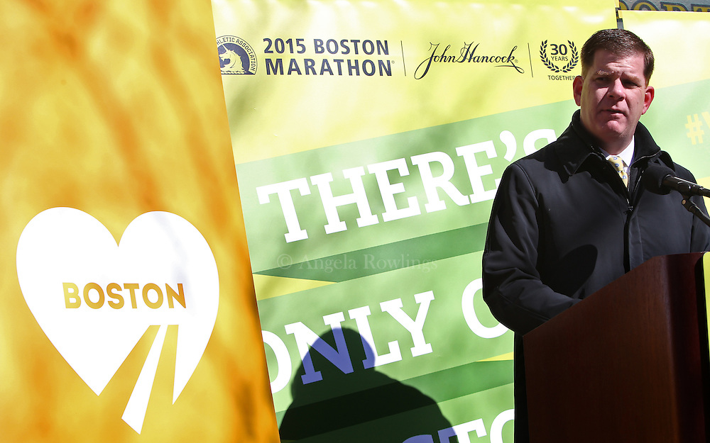 (Boston, MA - 3/19/15) Boston Mayor Martin Walsh announces that April 15 will be One Boston Day during the unveiling of the 2015 Boston Marathon street banners on Boylston Street, Thursday, March 19, 2015. Staff photo by Angela Rowlings.