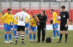 Bristol Rovers' Stuart Sinclair is helped by physio Phil Kite - Photo mandatory by-line: Neil Brookman/JMP - Mobile: 07966 386802 - 28/02/2015 - SPORT - Football - Gateshead - Gateshead International Stadium - Gateshead v Bristol Rovers - Vanarama Football Conference