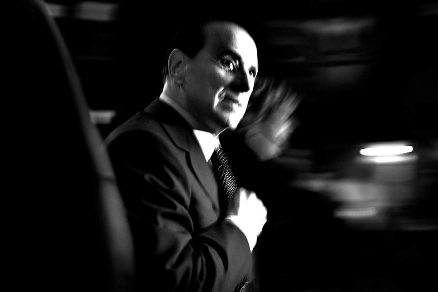 Italian Prime Minister Silvio Berlusconi rushes as he enter at La7 Tv studios to take part in 'Il processo di Biscardi' (Biscardi's trial), an Italian soccer talkshow conducted by italian anchor man Aldo Biscardi, at the LA7 television channel in Rome January 9, 2006. Berlusconi, looking to take advantage of a finance scandal buffeting his centre-left opponents, is launching a media blitz this week three months ahead of a general election.