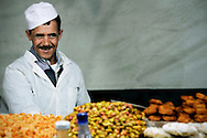 Morocco, Marrakesh. Smiling man during a break at his work in one of the restaurants in Djemaa el Fna.
