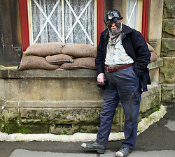 © Licensed to London News Pictures. <br /> 16/10/2016. <br /> Goathland, UK.  <br /> <br /> A man wearing 1940's period miner's clothing stands on the platform at Goathland station during the final day of the North Yorkshire Moors Railway Wartime Weekend event. <br /> The annual event brings together re-enactors and enthusiasts along the length of the NYMR heritage steam railway line to recreate the feel of the war years of the 1940's. <br /> <br /> Photo credit: Ian Forsyth/LNP