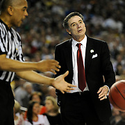 Atlanta, GA / 2013 - Louisville head coach Rick Pitino talks to his players on the court in the first half of the NCAA Final Four basketball championships Monday night at the Georgia Dome. Photo by Mike Roy/The Star-Ledger