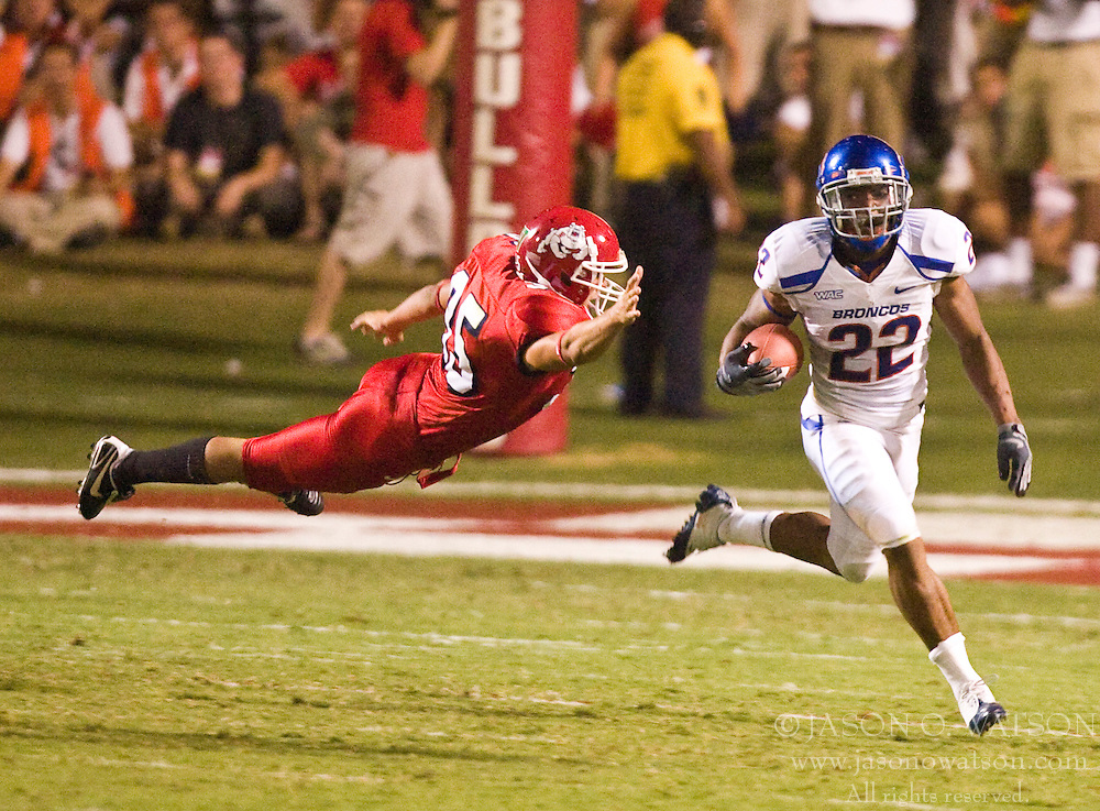Sep. 18, 2009; Fresno, CA, USA;  Boise State Broncos running back Doug Martin (22) rushes past Fresno State Bulldogs kicker Kevin Goessling (35) during the third quarter at Bulldog Stadium. Boise State defeated Fresno State 51-34.