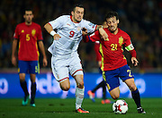 GRANADA, SPAIN - NOVEMBER 12:  David Silva of Spain (R) being followed by Elija Nestorovski of FYR Macedonia during the FIFA 2018 World Cup Qualifier between Spain and FYR Macedonia at  on November 12, 2016 in Granada, .  (Photo by Aitor Alcalde Colomer/Getty Images)