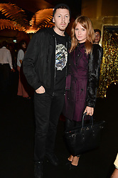 PROFESSOR GREEN and his wife MILLIE MACKINTOSH at the Vogue Pop Up Club at Westfield London to celebrate Westfield London's 5th birthday on 30th October 2013.
