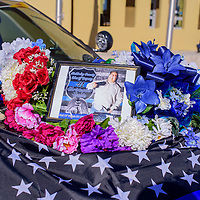 A memorial for Christopher Tsosie adorns the front of a McKinley County Sheriff's patrol vehicle outside the Law Enforcement Center in Gallup Friday.