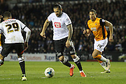 Derby midfielder Bradley Johnson heads for goal during the Sky Bet Championship match between Derby County and Hull City at the iPro Stadium, Derby, England on 5 April 2016. Photo by Aaron  Lupton.