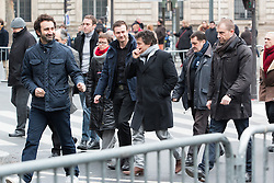 © Licensed to London News Pictures. 10/01/2016. France, Paris. Patrick Pelloux leaves after the anniversary ceremony on Place de le Republique alongside Mathieu Madenian surrounded by his 24/7 police protection. In front oToday January 10th 2016. Photo credit: Hugo Michiels/LNP