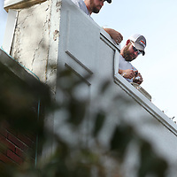 Adam Robison | BUY AT PHOTOS.DJOURNAL.COM<br /> Nathan Jackson and Justin White, employees for Tupelo Public Works Department, change bulbs out on the roof line above Rogers Realty and appraisal Company on Broadway Street Monday afternoon in Tupelo.