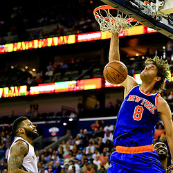 Mar 28, 2016; New Orleans, LA, USA; New York Knicks center Robin Lopez (8) dunks against the New Orleans Pelicans during the first quarter of a game at the Smoothie King Center. Mandatory Credit: Derick E. Hingle-USA TODAY Sports
