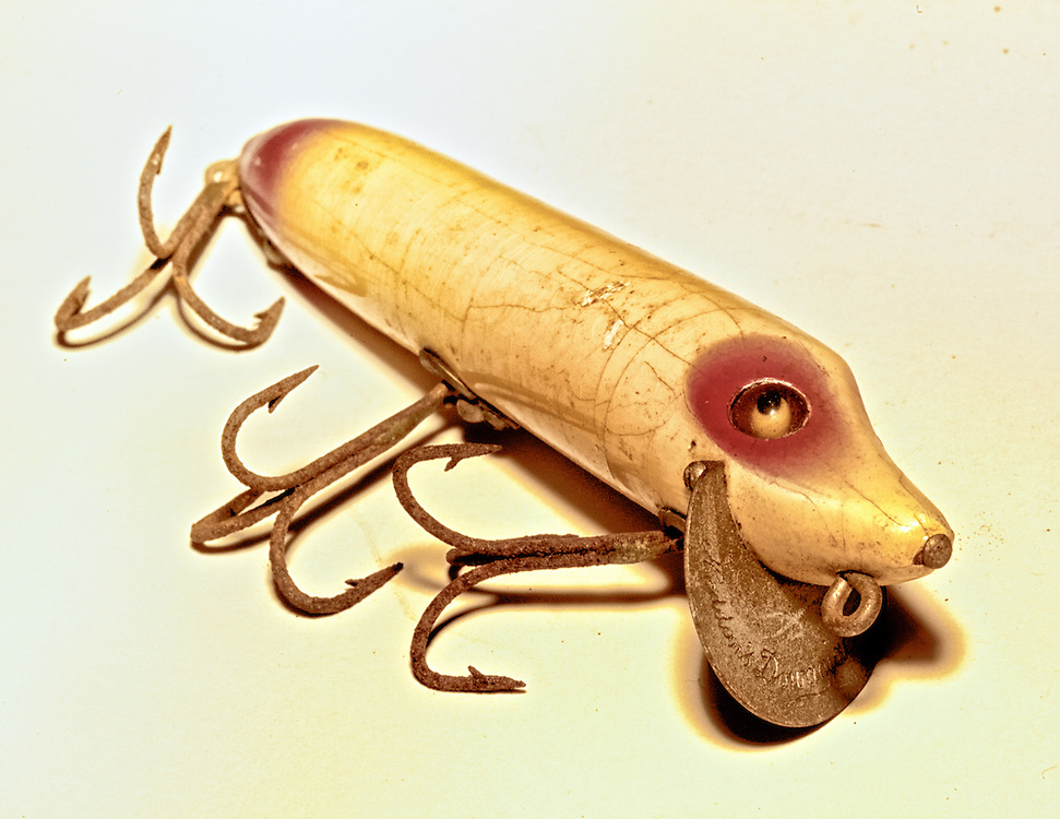 From my grandfather's tackle box, a vintage wooden fishing lure with glass eyes.