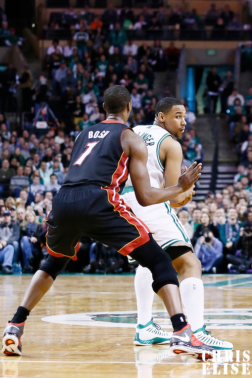 27 January 2013: Miami Heat center Chris Bosh (1) defends on Boston Celtics power forward Jared Sullinger (7) during the Boston Celtics 100-98  2OT victory over the Miami Heat at the TD Garden, Boston, Massachusetts, USA.