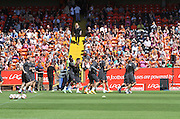 United warm up in front of the fans - Dundee United open day at Tannadice<br /> <br />  - Pictures © David Young