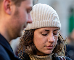 © Licensed to London News Pictures. 02/12/2019. London, UK. A Women cries at the Vigil at the Guildhall London for the victims of the London Bridge attack on Friday 29/11/2019. Photo credit: Alex Lentati/LNP