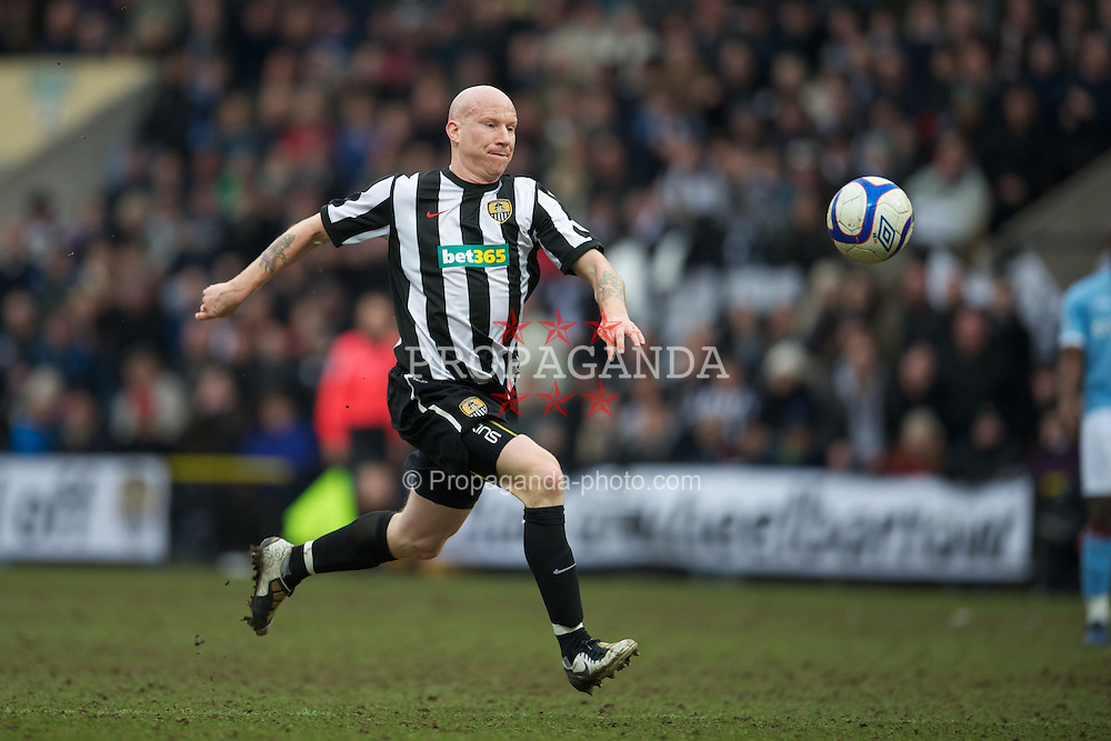 NOTTINGHAM, ENGLAND - Sunday, January 30, 2011: Notts County's Lee Hughes in action against Manchester City during the FA Cup 4th Round match at Meadow Lane. (Photo by David Rawcliffe/Propaganda)