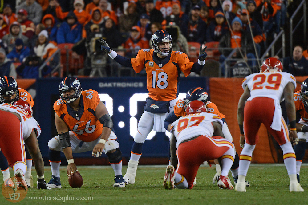 November 17, 2013; Denver, CO, USA; Denver Broncos quarterback Peyton Manning (18) signals at the line of scrimmage during the second quarter against the Kansas City Chiefs at Sports Authority Field at Mile High. The Broncos defeated the Chiefs 27-17.