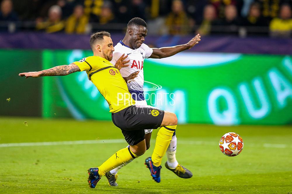 Tottenham Hotspur defender Davinson Sánchez (6) tackles Borussia Dortmund forward Paco Alcácer (9) during the Champions League round of 16, leg 2 of 2 match between Borussia Dortmund and Tottenham Hotspur at Signal Iduna Park, Dortmund, Germany on 5 March 2019.