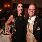 Nanci Searls, left, and Randy Searls pose for a picture Saturday December 6, 2014 during the 9th Annual Wilmington Fur Ball at the Country Club of Landfall in Wilmington, N.C. (Jason A. Frizzelle)