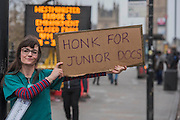 An anonymous junior Doctor gets support from passing traffic - The picket line at St Thomas' Hospital. Junior Doctors stage another 48 hours of strike action against the new contracts due to be imposed by the Governemnt and health minister Jeremy Hunt.