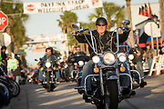 Leather clad bikers cruises down Main Street during the 74th Annual Daytona Bike Week March 8, 2015 in Daytona Beach, Florida. More than 500,000 bikers and spectators gather for the week long event, the largest motorcycle rally in America.