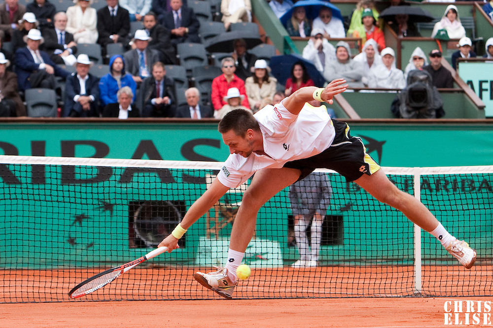 7 June 2009: Robin Soderling of Sweden stretches and misses the ball during the Men's Singles Final match on day fifteen of the French Open at Roland Garros in Paris, France.