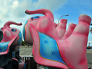Port Washington, NY: September 26, 2011---   A funny site... pink elephant carnival rides stored in the parking lot at North Hempstead Beach Park. © Audrey C. Tiernan