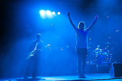 """© Licensed to London News Pictures. 08/06/2012. London, UK. The Charlatans perform live at Hammersmith Apollo, playing their 1997 and fifth studio album """"Telling' Stories"""" in its entirety.  In this picture L to R -  Martin Blunt, Tim Burgess, Jon Brookes.   Photo credit : Richard Isaac/LNP"""